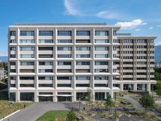 Berrel Berrel Kräutler Architekten und Herzog Architekten, beide aus Zürich, haben in Genf den Verwaltungsbau der Versicherung AHV erweitert.
